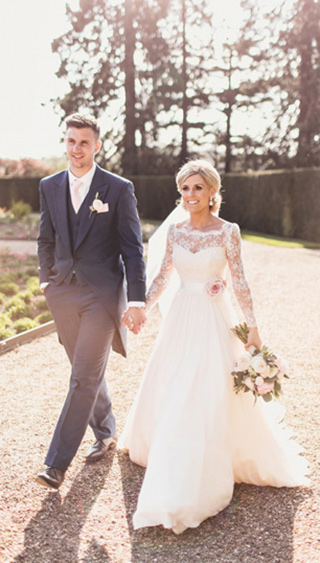 Happy bride and groom walking