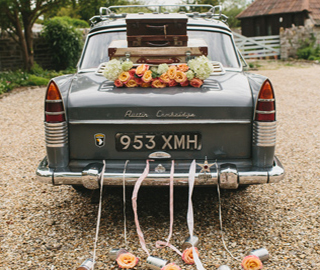Wedding car trailing tin cans